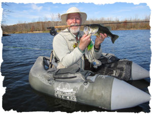 Jeff fly-fishing in Float Tube with Fish