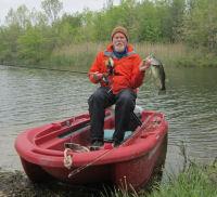 Jeff in Twin Troller X10 fishing boat, ruby red